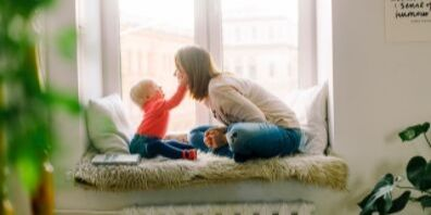 Mom playing with son in home